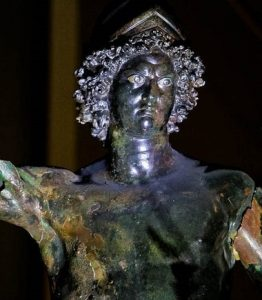 Bronze statue of the Roman god of war. The image shows head and chest.
