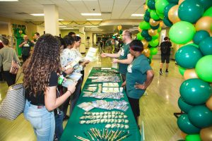 USF Libraries staff welcoming students to LIB Fest