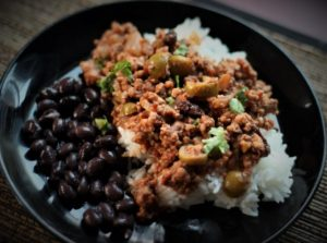 Image of Picadillo with rice and beans